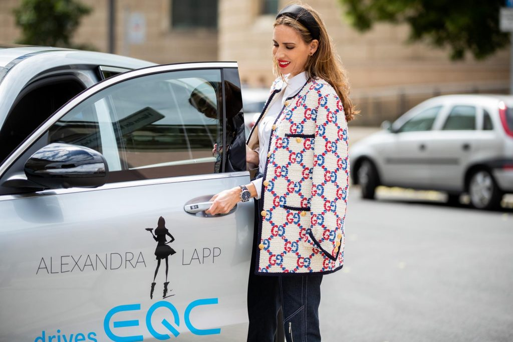 Alexandra Lapp in a Women and Technology look, is seen wearing a IWC Portofino Chronograph in front of a Mercedes EQC during MBFW Berlin.