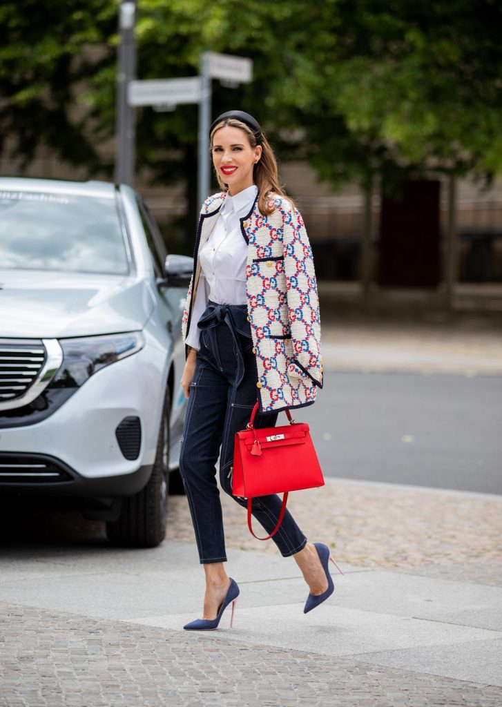 mbfwb_ss20_day2-380 (Copy)Alexandra Lapp in a Women and Technology look, is seen wearing a IWC Portofino Chronograph in front of a Mercedes EQC during MBFW Berlin.