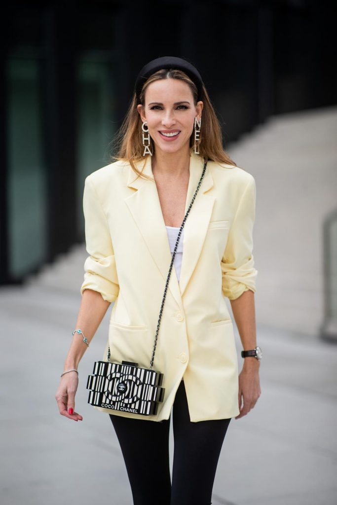 Alexandra Lapp is seen wearing an oversized yellow Zara blazer with black cycling/ biker leggings from H&M and a white James Perse tank top, black silk head band from Prada, Chanel metal and strass earclips, and a black and white Barcode Chanel Lego Brick bag on May 03, 2019 in Duesseldorf, Germany. (Photo by Christian Vierig/Getty Images)