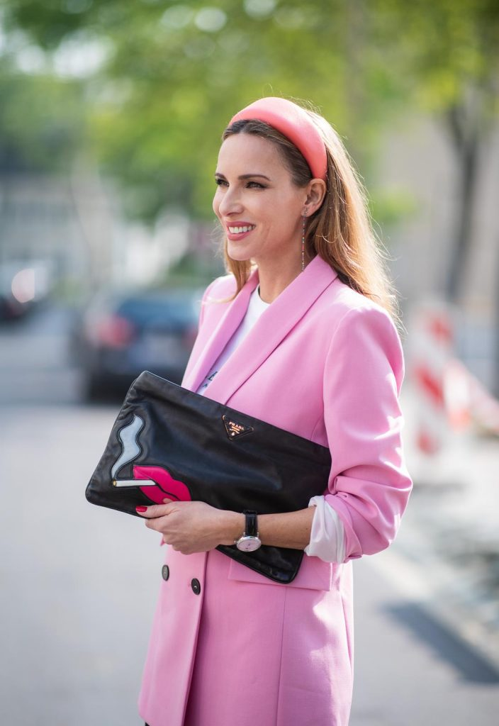 Alexandra Lapp is seen wearing a pink oversized blazer from Zara, a logo print t-shirt in black and white from Balenciaga, biker / cycling shorts from H&M, a pink silk satin hairband from Prada, a black clutch with a smoking red mouth print from Prada and the black pointed BB pumps from Balenciaga on May 04, 2019 in Duesseldorf, Germany. (Photo by Christian Vierig/Getty Images)