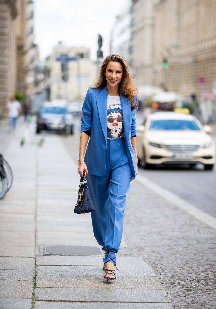 Alexandra Lapp is seen wearing a blue Zara suit, white Re/Done print T-shirt, blue Roger Vivier denim Viv' bag, white miu miu cat-eye shaped sunglasses during Berlin Fashion Week on July 02, 2019 in Berlin, Germany. (Photo by Christian Vierig/Getty Images)