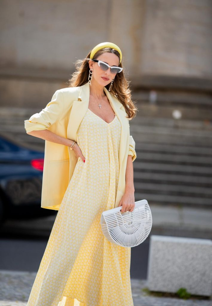 Alexandra Lapp is seen wearing a pale yellow oversized Zara blazer, a yellow and white printed slipi dress from Zara, Cult Gaia Ark White Bamboo Bag and white miu miu cat-eye shaped sunglasses during Berlin Fashion Week on July 02, 2019 in Berlin, Germany. (Photo by Christian Vierig/Getty Images)