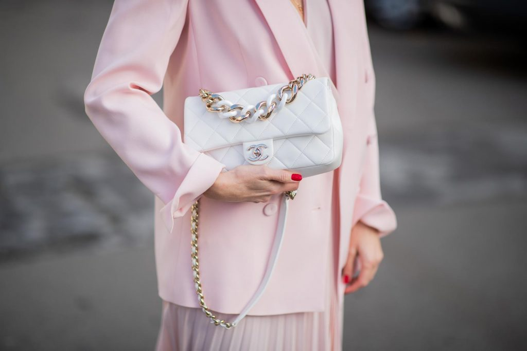 DUESSELDORF, GERMANY : Alexandra Lapp is seen wearing a monochrome look Riani, pink pleated dress, pink oversized blazer, white Chanel bag on December 11, 2019 in Duesseldorf, Germany. (Photo by Christian Vierig/Getty Images)
