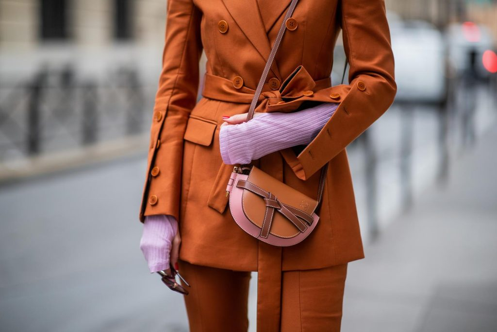 PARIS, FRANCE - FEBRUARY 25: Alexandra Lapp is seen wearing a suit style, Altuzarra suit, Rejina Pyo Net Sustain Candice ribbed jersey top, Loewe Gate mini shoulder bag in brown and Fendi sunglasses all from Net-A-Porter during Paris Fashion Week - Womenswear Fall/Winter 2020/2021 : Day Two on February 25, 2020 in Paris, France.