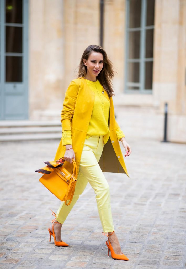 PARIS, FRANCE - FEBRUARY 26: Alexandra Lapp is seen wearing a yellow trend, leather coat in yellow from Milestone by Peter Hahn, yellow Looxent pullover from Peter Hahn, MYBC Jeans from Peter Hahn, slingback-pumps in orange from The Attico, 28 Hermes Kelly bag in orange, silk scarf from Hermes during Paris Fashion Week - Womenswear Fall/Winter 2020/2021 : Day Three on February 26, 2020 in Paris, France.