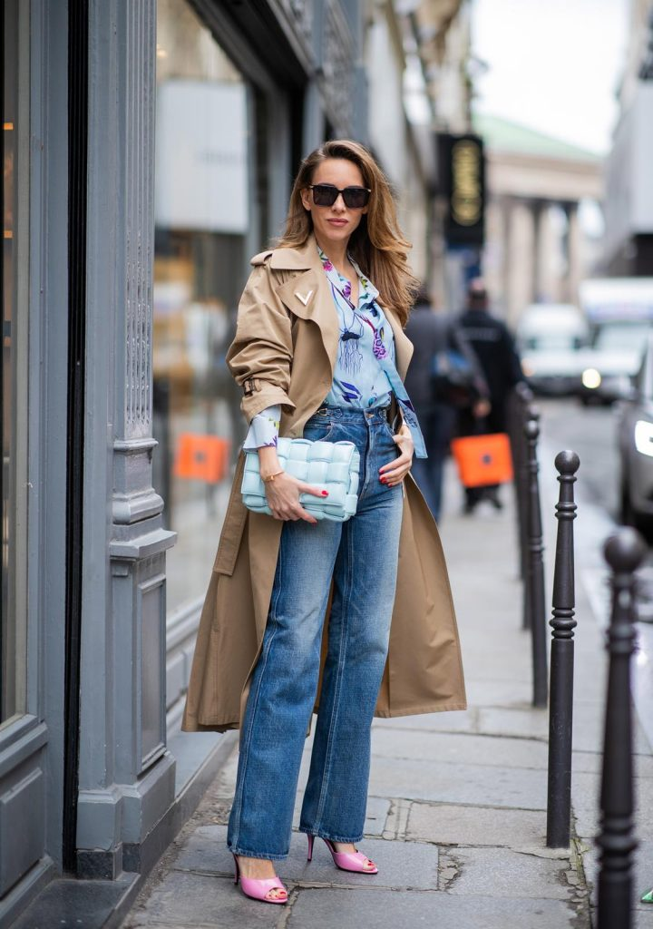 PARIS, FRANCE - FEBRUARY 25: Alexandra Lapp is seen wearing Jeans Jane Flare from Celine, double breasted trench coat from Valentino, Stella McCartney blouse, Bottega Veneta Padded Cassette bag in leather in light blue, Bottega Veneta sunglasses - all from Breuninger during Paris Fashion Week - Womenswear Fall/Winter 2020/2021