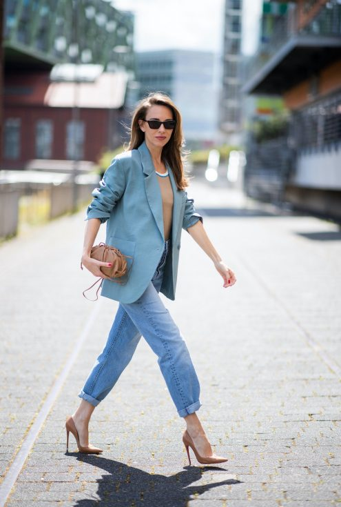 DUSSELDORF, GERMANY - JUNE 09: Alexandra Lapp is seen wearing a casual chic look, Victoria Beckham tanktop in beige, GRLFRND high waist Jeans Devon, double breasted blazer in blue from Low Classic, the Pouch mini clutch from Bottega Veneta and Dylan cat-eye sunglasses in black with silver all from NET-A-PORTER is seen on June 09, 2020 in Dusseldorf, Germany.