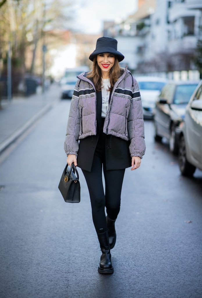 Alexandra Lapp is seen wearing one of her puffer jackets, CHRISTIAN DIOR puffer jacket in black and white, Zara puffer hat in Black, CHRISTIAN DIOR blazer in Black, CHRISTIAN DIOR t-shirt in white, CHRISTIAN DIOR St Honoré Tote bag in black.