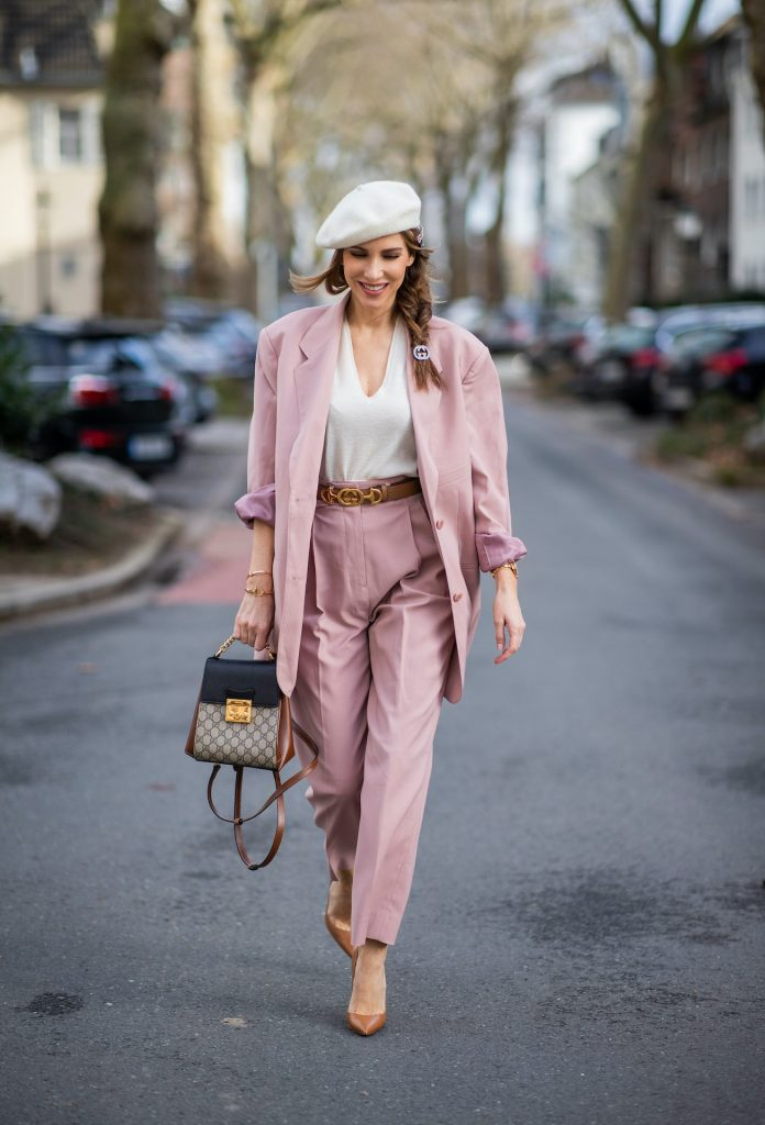 Alexandra Lapp is seen wearing pastel suits from FRANKIE SHOP Pernille single-breasted blazer and Pernille high-rise pants in pastel pink , vintage beret in off white, GUCCI logo belt in camel, GUCCI monogram backpack in black and brown, GUCCI hair clips and CHRISTIAN LOUBOUTIN Kate pumps in camel.