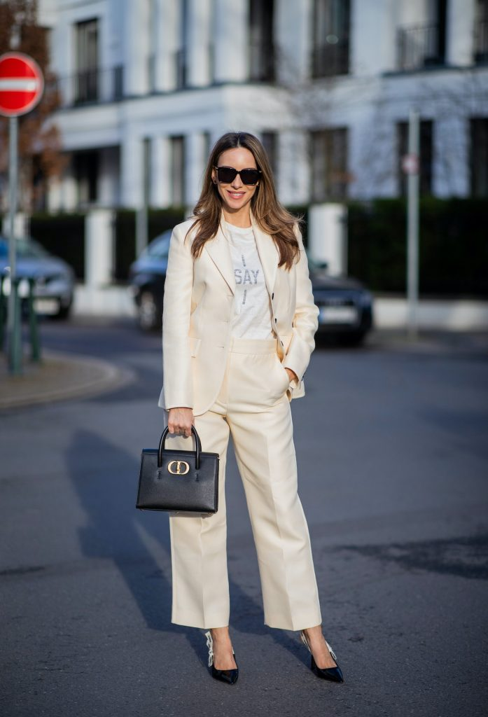 Alexandra Lapp is seen wearing pastel suits from CHRISTIAN DIOR blazer in creme, CHRISTIAN DIOR trousers in creme, CHRISTIAN DIOR t-shirt, CHRISTIAN DIOR St Honoré Tote bag in black, CHRISTIAN DIOR J'Adior Slingback pumps and BOTTEGA VENETA sunglasses in black.