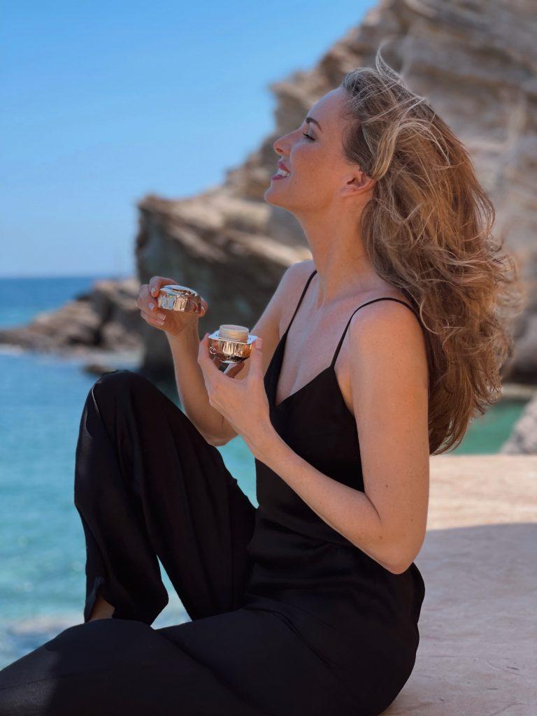 Alexandra Lapp enjoys her new skincare routine with Clé de Peau Beauté on the beautiful island of Ios in Greece.